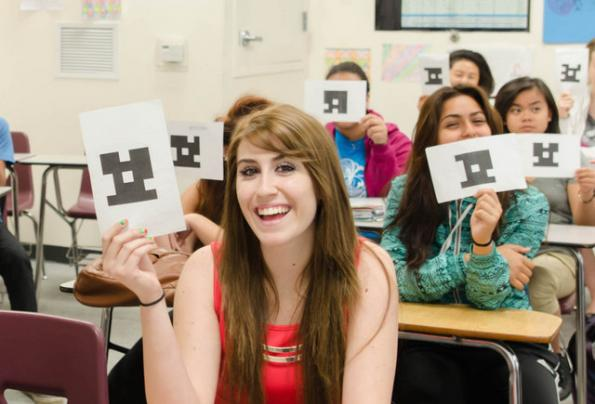 students showing plickers cards